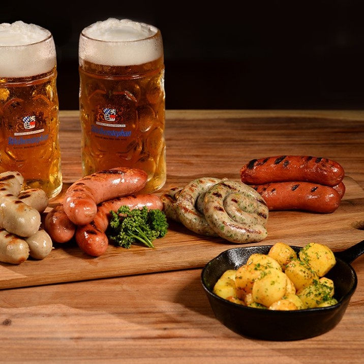 Homemade Sausage Sampler with Roasted Potatoes and Weihenstephan Beers